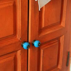 Dated pine cupboard doors transformed and fitted with replacement blue ceramic knobs